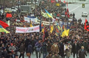 "Demonstrators protest against Ukraine's incumbent president Leonid Kuchma in capital Kiev Tuesday, Dec. 19, 2000.  Poster on the left reads: ""Freedom of speech! Kuchma resign!""  Some 5,000 protesters are taking part in the action ""Ukraine without Kuchma"". (AP Photo/Viktor Pobedinsky)"